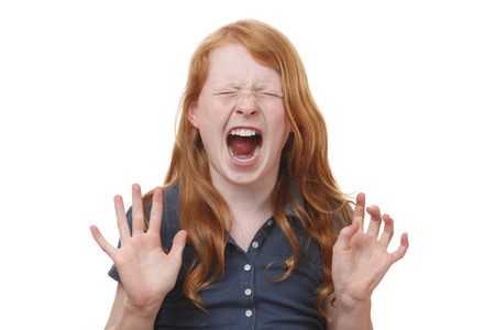 Portrait of a screaming young girl on white background