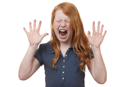 Portrait of a screaming young girl on white background photo