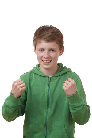 Portrait of a winning young boy on white background photo