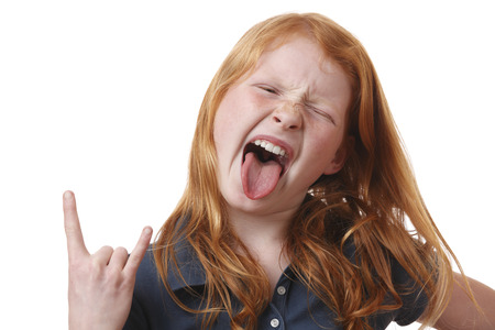 Portrait on an angry young girl on white background photo