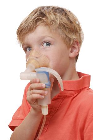inhale: Sick boy inhales some medicine on white background Stock Photo