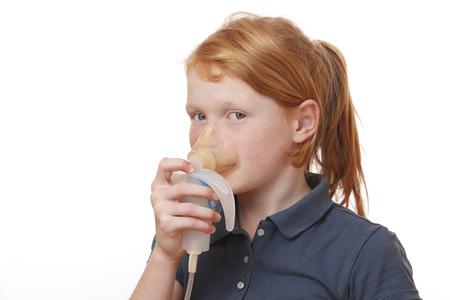 inhale: Sick girl inhales some medicine on white background