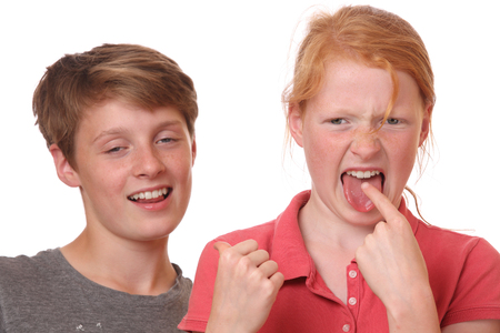 Portrait of two funny grimacing teenagers Stock Photo