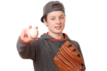 Portrait of a teenage boy with baseball and glove on white background Stock Photo
