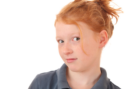 Portrait of a skeptical young teenage girl on white background Stock Photo