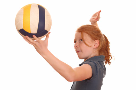 Portrait of a young girl with volleyball on white background