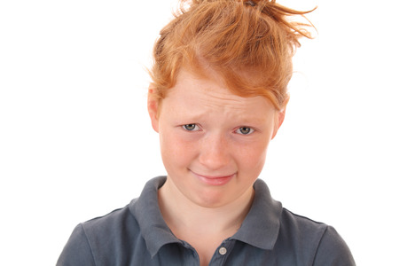 skeptical: Portrait of a skeptical young teenage girl on white background Stock Photo