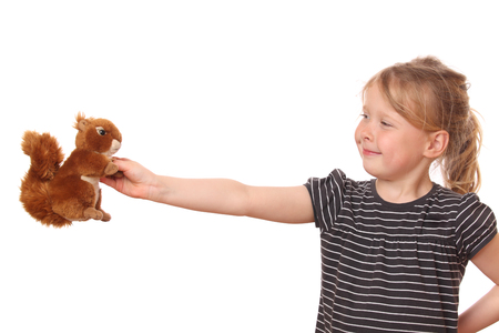 stuffed animal: Portrait of a young girl with stuffed animal on white background