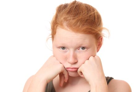 Portrait of a sad teenage girl on white background Stock Photo