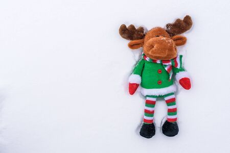 Christmas-tree toy deer on the snow. With a copy-space. Stock Photo