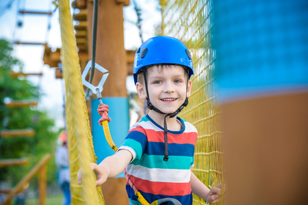 Young boy playing and having fun doing activities outdoors. Happiness and happy childhood concept. Stock Photo