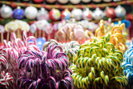 Stall with traditional colorful and festive candies at the Christmas Market. Candies are very popular at such markets. Selective focus