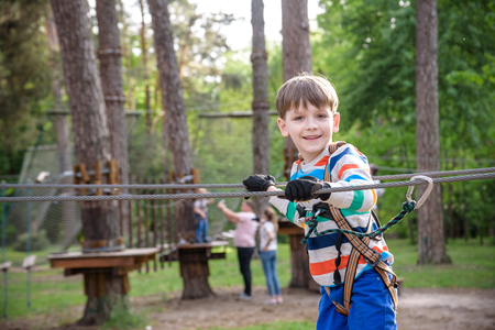 Cute child boy playing. Artworks depict games at eco resort which includes flying fox or spider net. Every childhood matters. Toddler age. Children fun. Stock Photo - 124702561