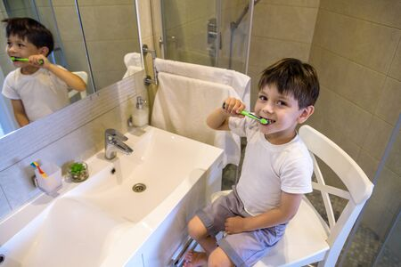 Cute toddler boy brushing teeth. Teeth cleaning, dental care. adorable baby boy washing up.