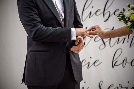 Wedding day. The groom places the ring on the brides hand. Photo closeup. Stock Photo
