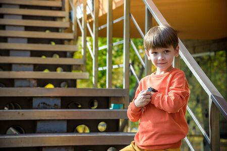 Photo of the boy looking at a smart watch. Children and modern technology. Kid calling to his friends or parents after school. Reklamní fotografie