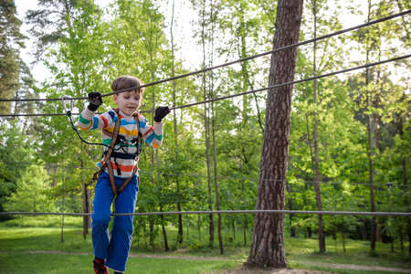 Cute child boy playing. Artworks depict games at eco resort which includes flying fox or spider net. Every childhood matters. Toddler age. Children fun.