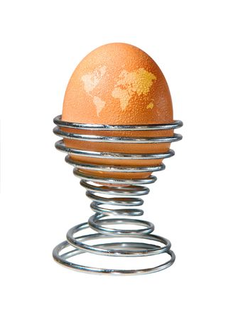 developed: An egg in an eggcup with beads of condensation and markings on the shell depicting a map of the world. Developed as a concept piece to adress global warming and its effect on animal welfare.  Stock Photo