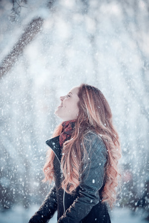 Smiled and happy girl with snow