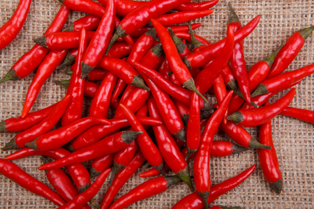 sackcloth: chillies on sackcloth Stock Photo