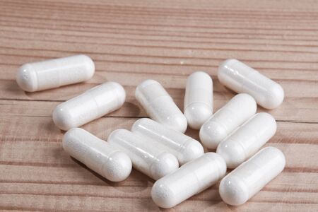 white pills: white pills on wood