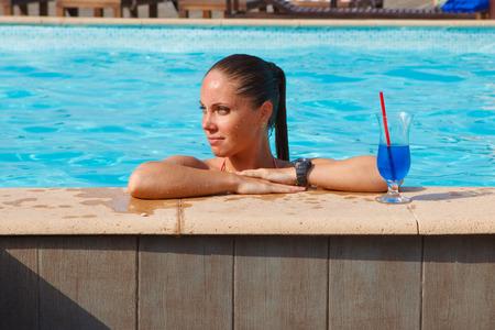 near: girl with cocktail near pool