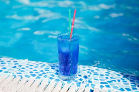 near: blue cocktail near pool Stock Photo