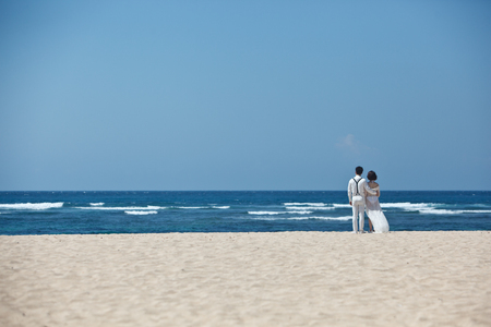 bride and groom couple on the ocean shore