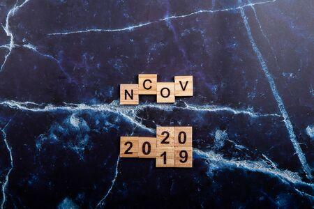 ncov coronavirus wooden word