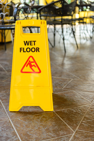 mopped: Yellow wet floor sign on the floor