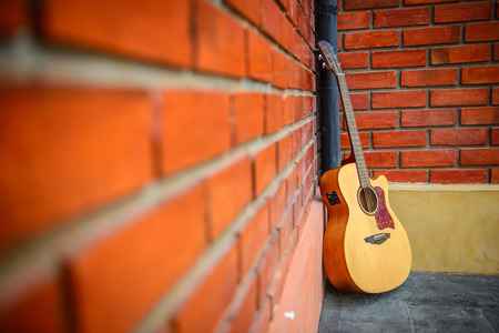 Guitar with red brick background  photo