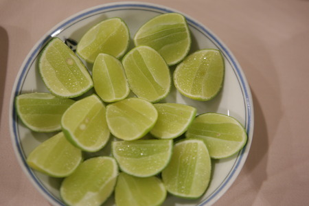 astringent: Sliced lime on a plate. Stock Photo