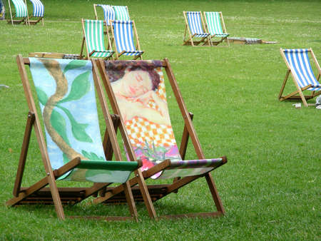 A colourful deck chairs in St James park at London           photo