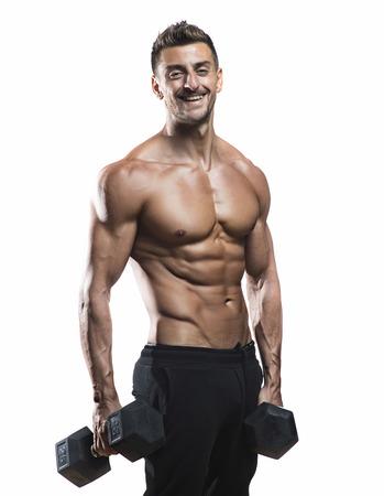 mature athlete posing with dumbells, dramatic lighting on white background Stock Photo