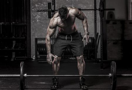 ピックアップのバーベルについて筋肉マン 写真素材