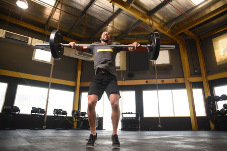 strong: Strong man doing a crossfit power lift Stock Photo