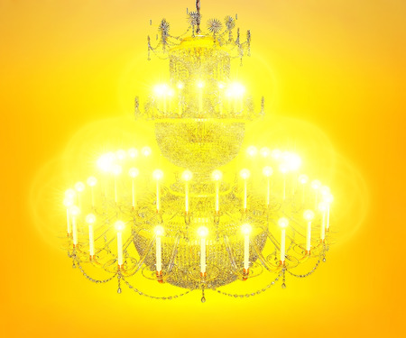 crystal chandelier: Three-level crystal chandelier with the burning candles. Stock Photo