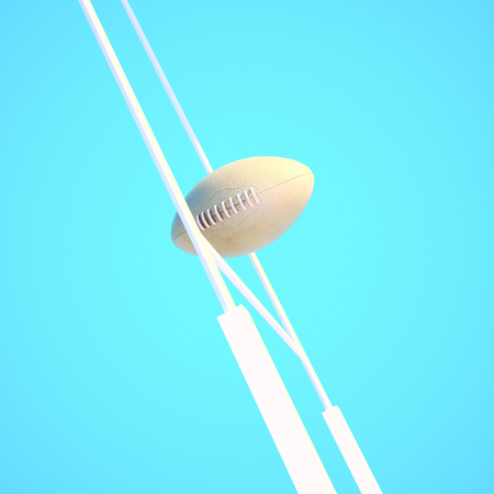 rugby team: Rugby ball against rugby goalpost and sky. Stock Photo