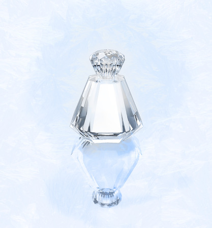 the silvery: Perfume in a glass bottle on a frosty silvery background.