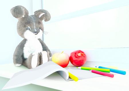 windowsill: Toy rabbit, apples, album, colored pencils on the windowsill.