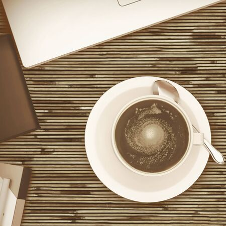 cafe table: Overhead view of white cup of coffee on a wooden cafe table.