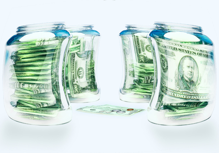 Glass flasks with money and three banknotes with coins - wealth and poverty concept. Stock Photo