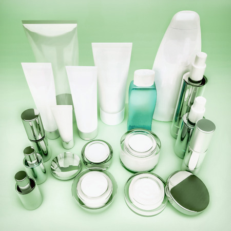 skin care products: Set of cosmetic containers. Skin care products on green.