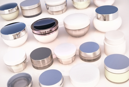 cremas faciales: Lines of jars of face creams. The view from the top.