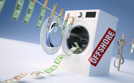 handcuffs: Concept of money laundering, money hanging on a rope coming out of the washing machine, money jump into the washing machine. Stock Photo