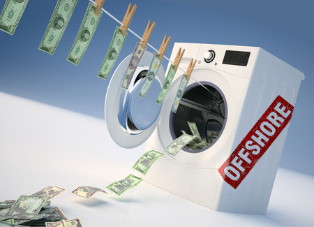 Concept of money laundering, money hanging on a rope coming out of the washing machine, money jump into the washing machine. Stock Photo