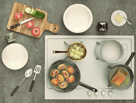 hobs: Stone countertop with gas hobs and products. Delicious eating concept with pies, fish and fresh vegetables. Top view.  Stock Photo
