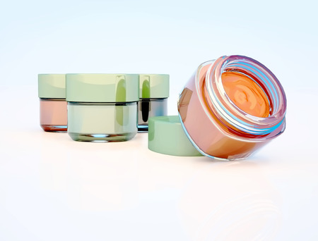 Cosmetic jars of clay isolated on a light background. One jar is open.