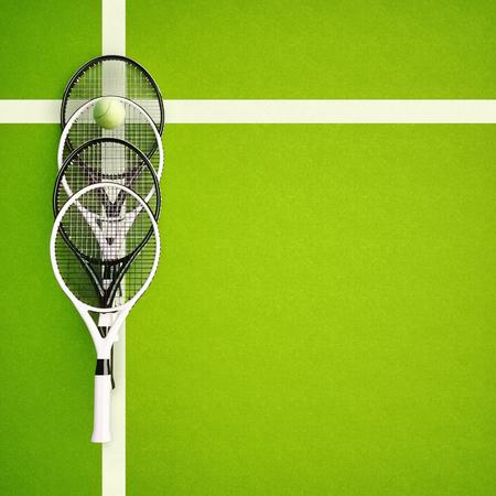 Tennis rackets near a yellow ball on a green court.