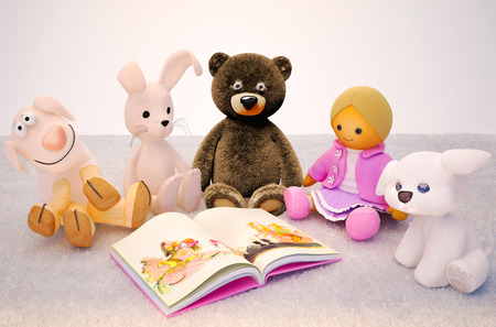 storybook: Baby toys and interesting book located on the carpet. Children education and development happy childhood.